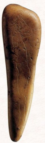 Profile of humanoid figure from the Madeleine culture on a small stone