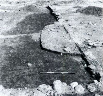Traces after plowing with ard under long burial mound