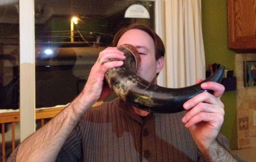 Eric Wentling drinks Minnesota beer of a horn