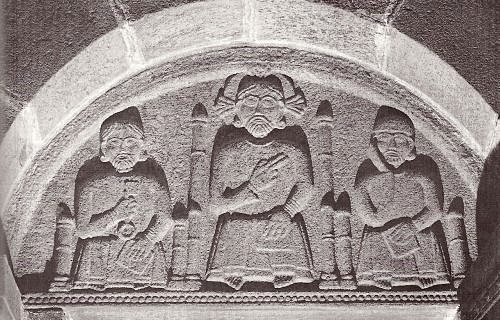 Relief over doorway in Anst Church between Kolding and Ribe. Jesus in the middle and on his right Peter with the keys of heaven and on his left Paul with the Bible in his hand
