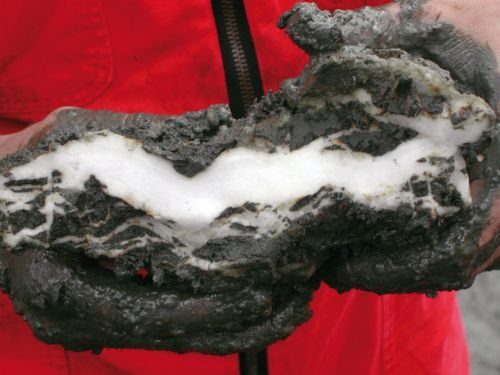 A piece of frozen  methane hydrates brought up from the seabed off the American state of Oregon