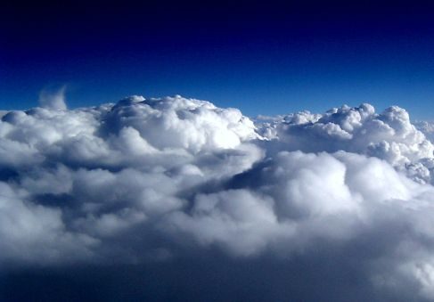 Topside of clouds viewed from an airplane window