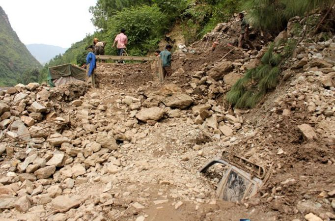 Heavy monsoon rain  has washed away a road at Kosi river in the Himalayas