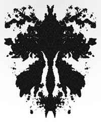 An ink blot looking like a female genitalia, orchid or microscopic aquatic animal