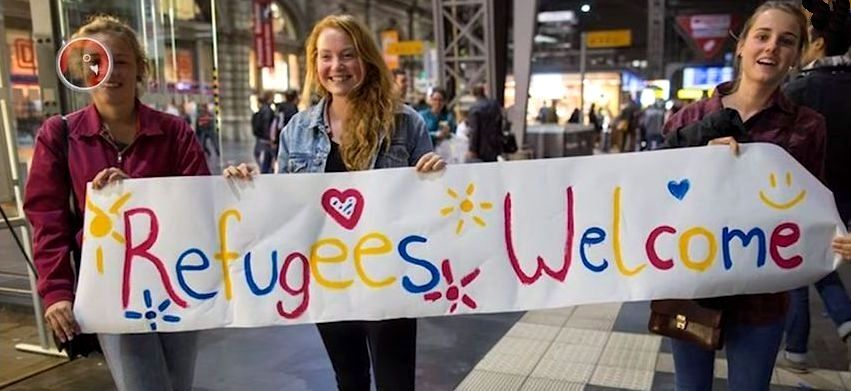 Young girls welcome Muslim immigrants