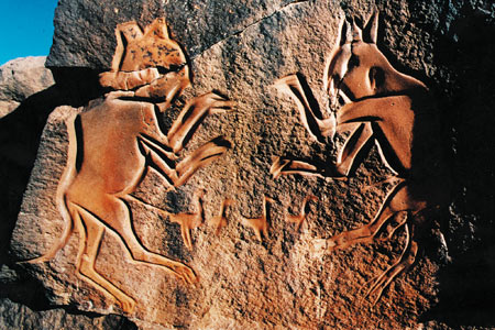 Stone carving with fighting cats in the desert in Libya