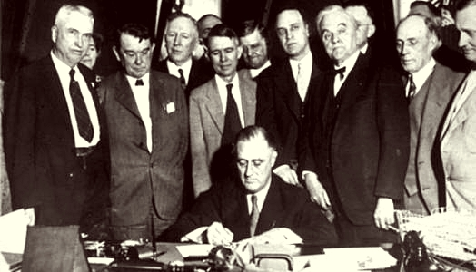 Franklin D. Roosevelt signs the law on the Tennessee Valey Project May 18, 1933