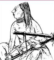 Chinook indian from the American West coast with a baby in a wooden squize