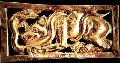 A little figure in gold - A dog or a wolf-like animal fights against a snake - The Hermitage St. Petersburg -  found in Asia Minor