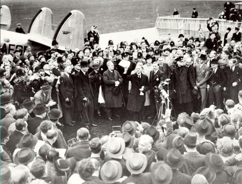 Neville Chamberlain showing the Anglo-German Declaration to a crowd at Heston Aerodrome at his homecoming from Munich 30. September 1938